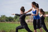 foto of  practices  - group of young people practicing in an outdoor yoga class - JPG