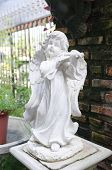 picture of garden sculpture  - Decorative cupid playing violin sculpture in the garden