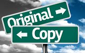 picture of plagiarism  - Original x Copy creative sign with clouds as the background - JPG