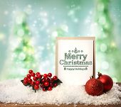 stock photo of mistletoe  - Merry Christmas card with baubles mistletoe and snow flakes - JPG