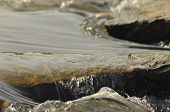 stock photo of crystal clear  - Stones in the river - JPG