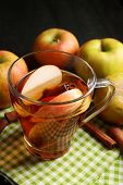 foto of cider apples  - Apple cider with cinnamon sticks and fresh apples on wooden background - JPG