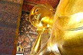 foto of recliner  - Reclining Buddha gold statue Wat Pho Bangkok Thailand - JPG
