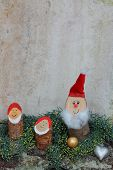 stock photo of gnome  - rustic homemade christmas decoration with happy gnomes - JPG