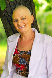 stock photo of chemotherapy  - Happy smiling cancer survivor after successful chemotherapy. ** Note: Soft Focus at 100%, best at smaller sizes - JPG