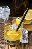 pic of whiskey  - Glass with Whiskey Sour and ice cubes  - JPG