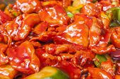 stock photo of buffet  - Closeup of chinese sweet and sour chicken meal on display at a hotel restaurant buffet - JPG