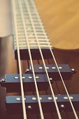 picture of pick up  - black bass guitar close-up close-up string pick-up ** Note: Shallow depth of field - JPG