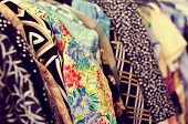 stock photo of flea  - some used clothes hanging on a rack in a flea market - JPG