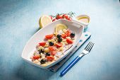 stock photo of black-cherry  - octopus salad with cherry tomatoes and black olives - JPG