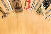 image of workbench  - Carpentry workbench with different tools on wooden background - JPG