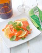 image of redfish  - salad on salmon on the white plate - JPG