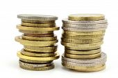 picture of copper coins  - Two stacks of silver gold and copper coins - JPG