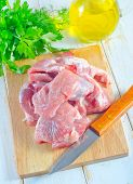stock photo of raw chicken sausage  - raw meat and knife on the kitchen table - JPG