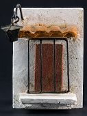 image of pumice-stone  - lamppost above door with iron grill pumice - JPG