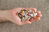 stock photo of kidney beans  - Man holding 15 assorted mixed beans and legumes in his hand including kidney lima black - JPG