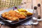 picture of cod  - Fried fillet of cod with french fries on a dark plate - JPG