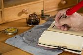 stock photo of treasure  - Taking notes in the diary of their trip treasure  - JPG