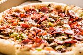 stock photo of take out pizza  - Homemade pepperoni pizza with vegetables in carton box - JPG