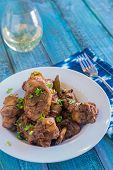 foto of thighs  - Chicken thighs marinated and cooked in adobo sauce - JPG