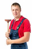 foto of plumber  - proud plumber with a rubber plunger on a white background - JPG