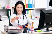 image of antidepressant  - Happy young female doctor giving pills - JPG