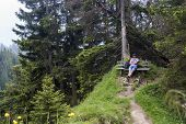 foto of bavarian alps  - Hiker takes a break and enjoys the view in the Bavarian Alps Germany - JPG