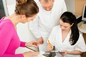 stock photo of doctors office  - Patient in reception area of office of doctor or dentist - JPG