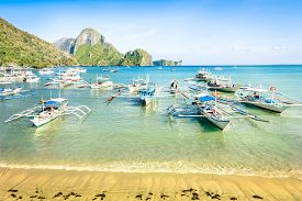 picture of south east asia  - Front beach with longtail boats in El Nido - Beautiful tropical destination in Palawan Philippines - Travel concept in exclusive locations in south east asia - Nature wander trip around the world