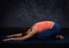 picture of ashtanga vinyasa yoga  - Beautiful sporty fit yogini woman practices yoga asana balasana  - JPG