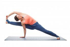 image of ashtanga vinyasa yoga  - Beautiful sporty fit yogini woman practices yoga asana visvamitrasana  - JPG