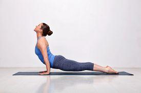image of ashtanga vinyasa yoga  - Beautiful sporty fit yogini woman practices yoga asana urdhva mukha svanasana  - JPG