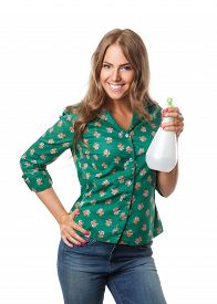 stock photo of trigger sprayer bottle  - Beautiful happy Woman Holding A Watering Spray Bottle isolated on white - JPG