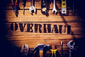 stock photo of overhauling  - The word overhaul against desk with tools - JPG