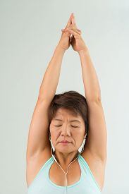 picture of mudra  - Japanese woman listening to the music with her hands in meditation mudra - JPG