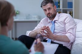 picture of depressed  - Image of depressed man listening his therapist advice - JPG