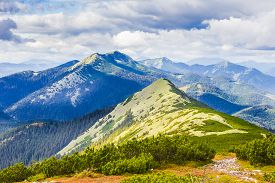 picture of mountain-range  - Carpathian landscape with mountain peaks mountain ranges forested slopes placer of stones mountain pasture and sky with clouds - JPG