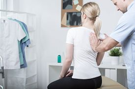 image of physiotherapist  - Chiropractic doing spinal mobilisation in physiotherapist - JPG