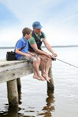 picture of fly rod  - Father and son fishing in lake - JPG