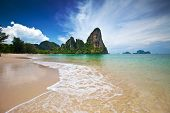 stock photo of off-shore  - Famous limestone cliffs of Krabi bay overlooking wide sandy beach off west coast of Thailand - JPG