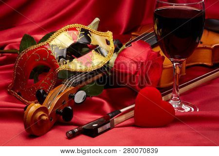 Violin fiddle theater mask red