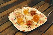A Group Of Beer Samples In Vintage Like Glasses On A Vintage Like Plate. poster