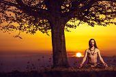 Yogi man meditating at sunset on the hills. Lifestyle emotional relaxation emotional concept spiritu poster