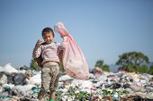 Poor Children Collect Garbage For Sale Because Of Poverty, Junk Recycle, Child Labor, Poverty Concep poster