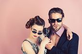 Couple In Love In Glasses Sing In Microphone. Singer Man And Woman With Retro Hair And Makeup. Pinup poster