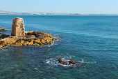 Ruins of a protective fortification. Mediterranean sea, the ancient city of Akko, spring day