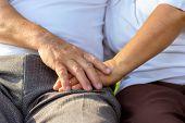 Close Up Older Couple Hands. Older Husband Use Hand Hold Older Wife's Hand Together For Encouraging  poster