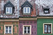 Fragment Of The Facade Of Historic Tenement Houses In The Winter On The Market Square In Poznan poster