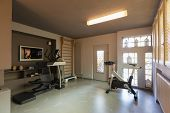 Private gym with exercise bikes, treadmills and espalier for exercises. Nobody inside poster