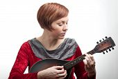 Woman playing mandolin